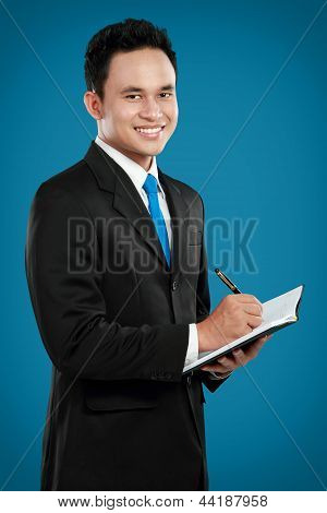 Young Business Man Writing