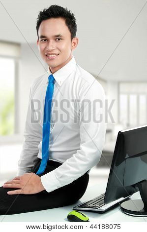 Young Asian Business Man At The Office
