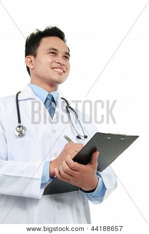 Medical Doctor Writing On Clipboard