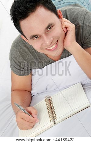 Asian Male With His Diary