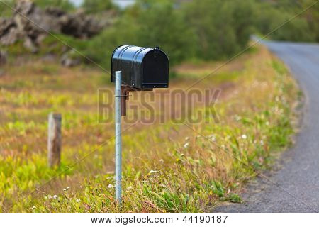 Old Weathered Mailbox At Rural Roadside In Iceland