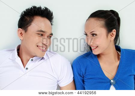 Young Happy Couple Looking Each Other Smiling