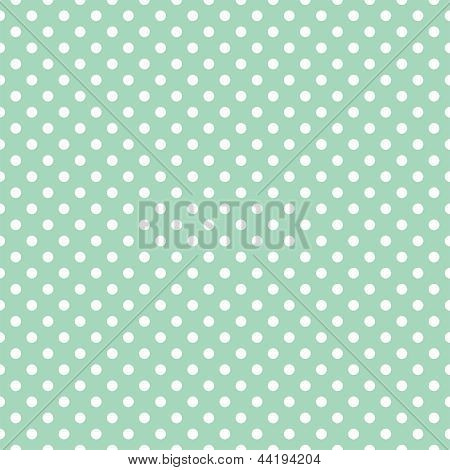 Seamless vector pattern with white polka dots on a retro vintage mint green background.