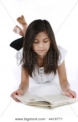 Little Girl Reading Or Studying