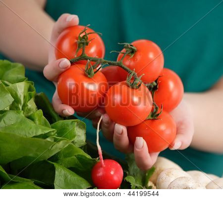 Woman Holding Fresh Tomatoes