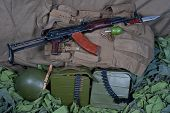 stock photo of akm  - Vintage background Concept with AK 47 rifle - JPG