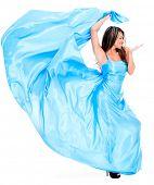 stock photo of flirtatious  - Woman in a beautiful long blue dress  - JPG