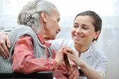 stock photo of handicapped  - Senior woman with her caregiver at home - JPG
