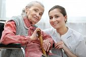 image of crutch  - Senior woman with her caregiver at home - JPG