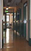picture of mrsa  - image of an empty hospital corridor with a wheelchair at the end of it - JPG