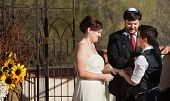 picture of rabbi  - Happy lesbian couple with rabbi in civil union ceremony - JPG