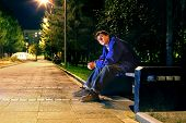 picture of banquette  - lonely teenager sitting in the night park alone - JPG