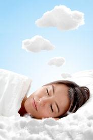 foto of sweet dreams  - Peaceful woman sleeping on a cloud and having sweet dreams - JPG