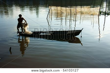 Fisherman Cast A Net On River