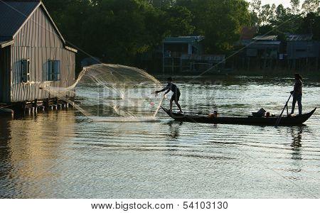 Fisherman Cast A Net On River