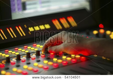 Male Hand On Control Film Mixing Console