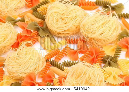 different pasta in three colors close-up.