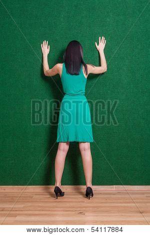 backside image of lady weared green dress