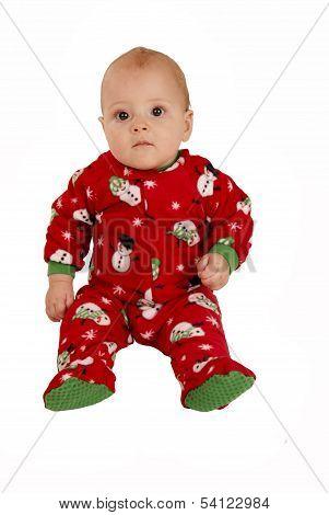 Toddler Boy Sitting In Red Snowman Pajamas