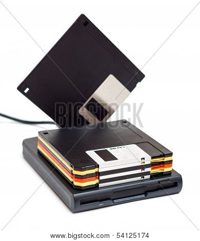 External Usb Floppy Disk Drive With Disks One Standing