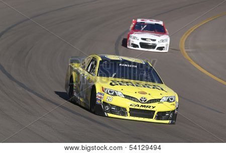Avondale, AZ - Nov 09, 2013:  Matt Kenseth (20) brings his race car through the turns during the AdvoCare 500 race at the Phoenix International Raceway in Avondale, AZ on Nov 9, 2013.
