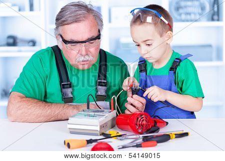 Grandfather And Grandchild Using Multimeter