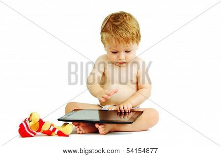 baby boy playing with a digital tablet white background.