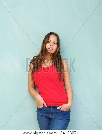 Relaxed Young Woman Standing Indoors With Hands In Pocket