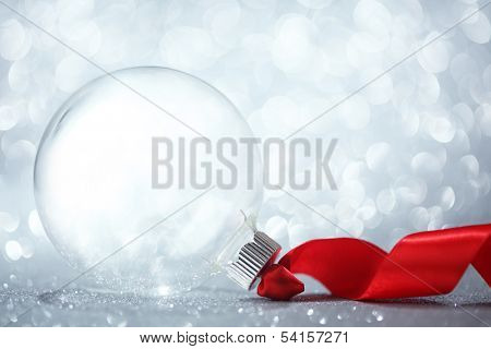 Empty Christmas ornament with red ribbon