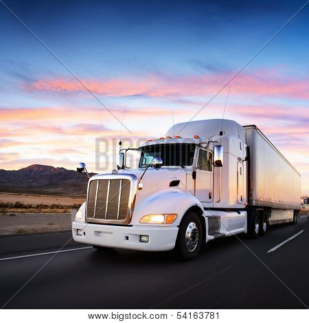 Truck and highway at sunset - transportation background