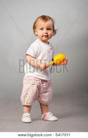 Baby Girl With Orange Maraca.