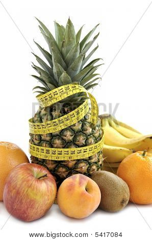 Fresh Fruit's Background With Measuring Tape.