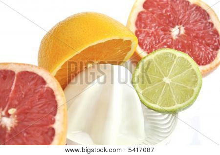 Juicer With Slices Of Grapefruit, Orange And Lime.
