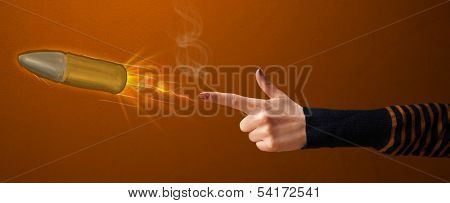 Gun shaped woman hand with bullet coming out of it
