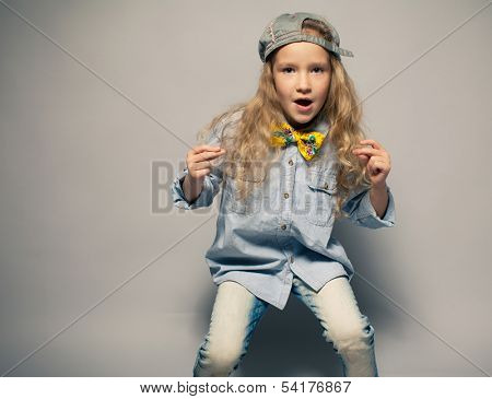 Dancing child. Motions fashion girl studio shot