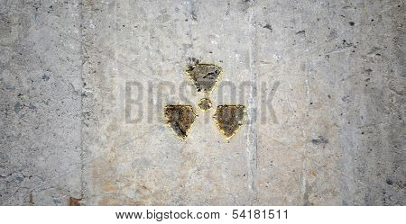 Grey wall with radioactivity symbol. Background image