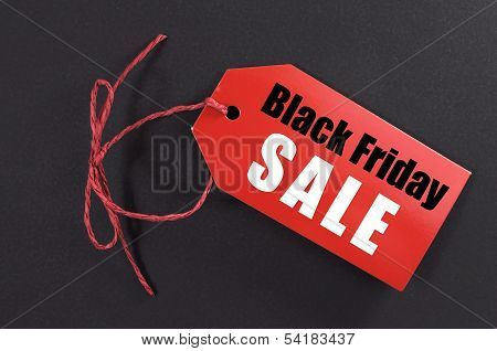 Black Friday Shopping Sale Concept With Red Tiket Sale Tag Close Up On Black Background.