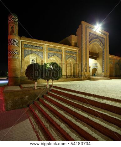 Oriental building with trees at night.The city of Khiva, Uzbekistan