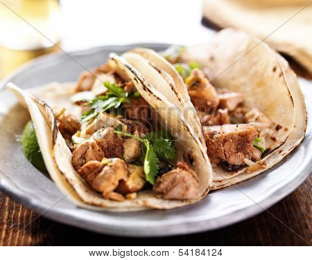 authentic mexican tacos with chicken and cilantro
