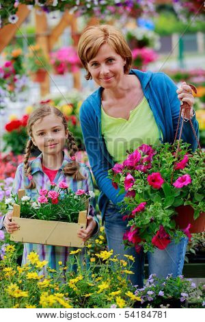 Flower, garden - Mother with daughter shopping plants and flowers in garden center