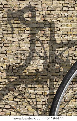 Bike Shadow Brick Wall