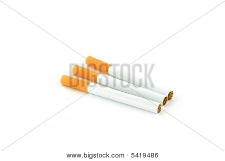 Three Cigarets On White Background