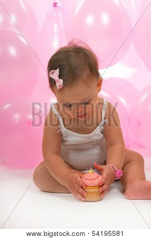 Baby eating her birthday cupcake