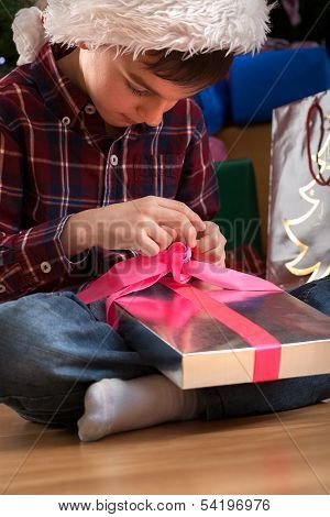 Young Boy Unpacking Present