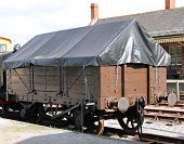 foto of covered wagon  - A Vintage Railway Wagon With a Tarpaulin Cover - JPG