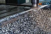 foto of groping  - CNC Milling Machine With Mound Scrap in Workshop - JPG