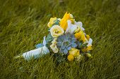 wedding bouquet on the green grass