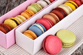 stock photo of french pastry  - Macaroons on a wooden table - JPG
