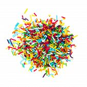 stock photo of jimmy  - decorating colored sugar jimmies isolated on white background - JPG
