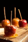 foto of toffee  - Close up of toffee apples on rustic board - JPG